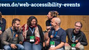 Excerpt from a stage group photo at the Accessibility Summit 2019; Sebastian Greger and others
