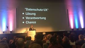 Sebastian Greger, presenting a German slide on privacy UX at WUDHH 2018